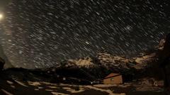 Time lapse of stars behind mountain Khumbila Stock Footage