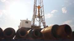 Drilling Rig Dolly Past Drill Pipe Stock Footage