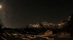 Time lapse of stars behind mountain Khumbila Stock Footage