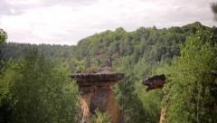 Sandstone rocks through the forest in Kokorin, Czech Republic. Stock Footage