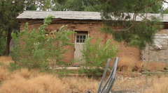 Abandoned old adobe brick house - stock footage