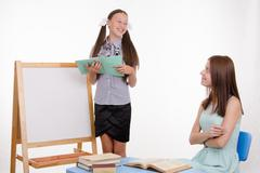 the pupil answers lesson at blackboard in classroom - stock photo