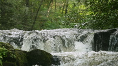 Slow Motion on the Bald River flowing over rocks in a peaceful scene Stock Footage