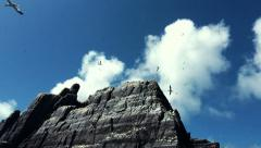 Pan of a Rocky Bird Island in Ireland, known as Little Skellig - stock footage