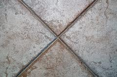 X formed by floor tiles Stock Photos
