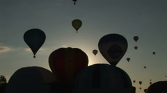 Beautiful image of Hot air balloons flying infront of morning sun Stock Footage