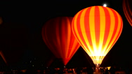 Stock Video Footage of Festival with Hot Air Balloons here seen making a night glow