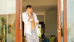Young sad man having headache in the morning by the villa HD Stock Footage