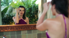 Beautiful woman cleaning her face with cotton pad in bathroom HD Stock Footage