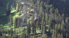 Snowbird Utah summer tram travels up mountain forest 4K 043 Stock Footage