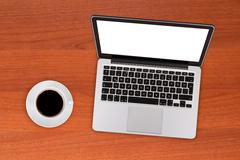 Stock Photo of laptop mock up with coffee
