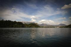 lake bled in slovenia. in the background, a medieval castle on the rock - stock photo
