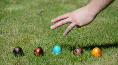 Family Easter game with painted colorful eggs on grass. Stock Footage