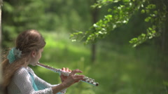 Stock Video Footage flute girl birchwood wind - stock footage