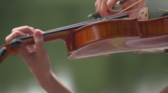 Stock Video Footage girl playing the violin nature Stock Footage