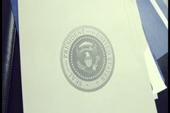 United States of America Government Oval Office - Documents on President's desk Stock Footage
