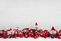 Red and white christmas background of wood with balls and goblin on the frame Stock Photos