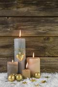 Traditional christmas decoration with four beige burning advent candles Stock Photos
