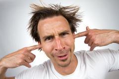 fingers in ears - stock photo