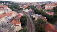 Passenger train pass over under the bridge in Prague Stock Footage