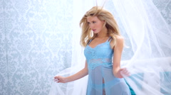 Beautiful vivacious woman with long blond hair Stock Footage