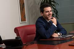 Smiling businessman looking at camera with reliability Stock Photos