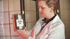 Doctor biohazard cannister bio hazard Stock Footage