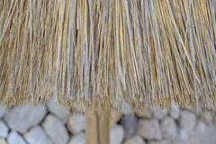 straw parasol closeup - stock photo