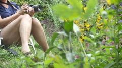 Photographer in garden Stock Footage