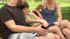 Very Young Parents, With Daughter Playing With Her Father's Hand, Detail Stock Footage