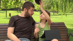 Very Young Father With His Daughter In Park Playing And Laughing, Outdoors Stock Footage