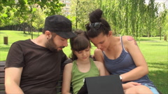 Very Young Parents, With Daughter Playing On A Tablet PC, Teenage Pregnancy Stock Footage