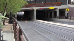 4K UHD Tucson streetcar underpass motorcycle riders coming out Stock Footage