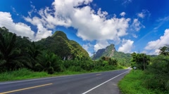 HD Time lapse. Mountain Road, moving clouds - stock footage