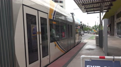 Stock Video Footage of 4K UHD Tucson streetcar passes by Centro Station close side shot
