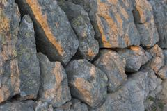 rock wall afternoon sunlight - stock photo