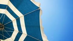 Sun umbrella waving in nice sunny weather Stock Footage
