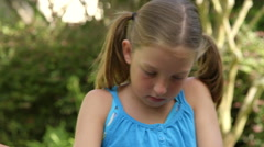 Close shot little girl planting flowers Stock Footage