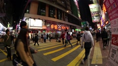 People look for attractions in colourful Mong Kok streets Stock Footage