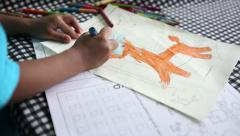 Little Asian Boy Colouring A Picture Stock Footage