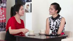Attractive Asian Women Spend Time Together In Cafe Stock Footage