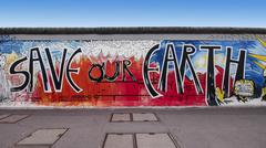 Graffiti on Berlin Wall at East Side Gallery Stock Photos