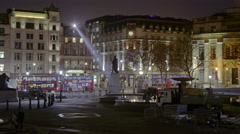 Panning, time-lapse of Trafalgar Square / Charring Cross at night Stock Footage