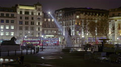 Zoom-out, time-lapse of Trafalgar Square / Charring Cross at night Stock Footage