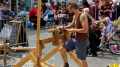 People watching spring pole lathe demonstration 3 Stock Footage