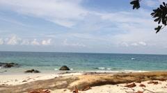 Beach, log and leaves at Lalang Island, Lumut, Perak, Malaysia, loop Stock Footage