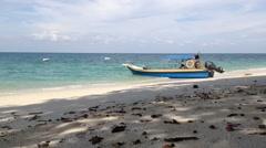 Beach and boat at Lalang Island, Lumut, Perak, Malaysia, loop Stock Footage