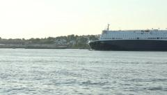 Ferry heads into port on a summer afternoon - Portland, Maine Stock Footage