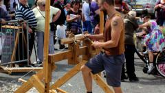 People watching spring pole lathe demonstration. Stock Footage