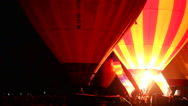 Stock Video Footage of Hot Air Balloons light up the night in a night glow
